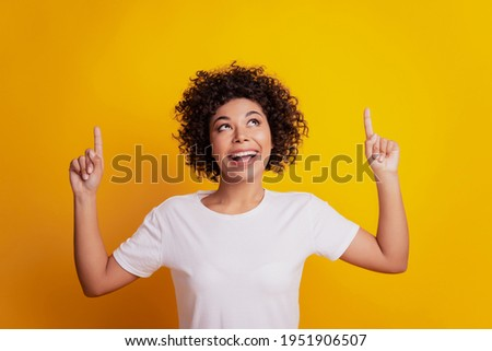 Portrait of funny multinational women pointing finger at cellphone Stock photo © deandrobot