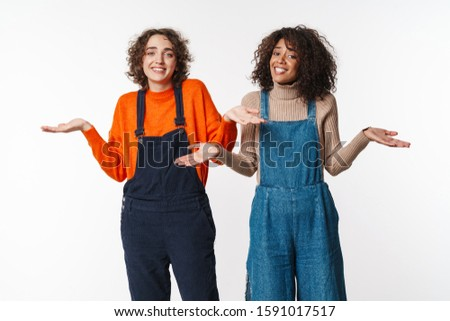 Portrait of nice women looking at camera and throwing up hands Stock photo © deandrobot
