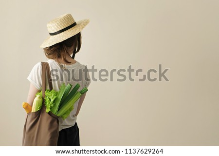 Corn in a reusable bag in the hands of a young woman. Zero waste concept BANNER, LONG FORMAT Stock photo © galitskaya