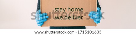 Home delivery with quote STAY HOME WE DELIVER on cardboard box banner. Food grocery delivered with g Stock photo © Maridav