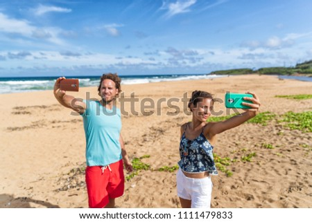 Self absorbed young people taking selfie pictures of themselves on beach vacation. Social media addi Stock photo © Maridav