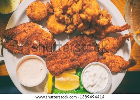Fried seafood platter top view of local dish from Key West, Florida, Conch fritters, cod fish in oil Stock photo © Maridav