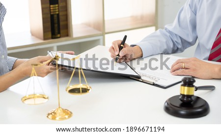 Client with his partner lawyers or attorneys discussing discussi Stock photo © snowing