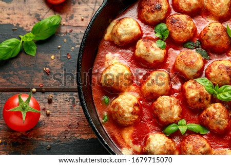 Beef traditional meatballs in tomato sauce in frying pan with pepper, garlic and parsley with onion  Stock photo © DenisMArt