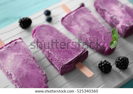 Homemade blackberry and cream ice-creams or popsicles with frozen berries Stock photo © dash
