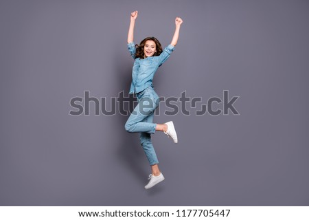 Full length image of nice excited woman jumping with throwing up hands Stock photo © deandrobot