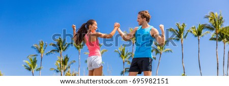 Challenge success runners people high fiving for fitness goal achievement. Athletes couple cheering  Stock photo © Maridav