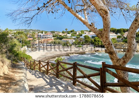 Pathway fenced with wooden railings lead to Benisa beach. Costa  Stock photo © amok