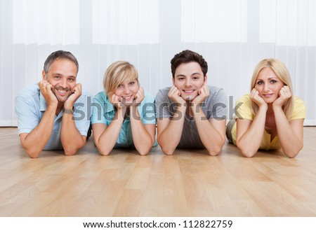 happy family lying with their heads close together and shouting Stock photo © get4net