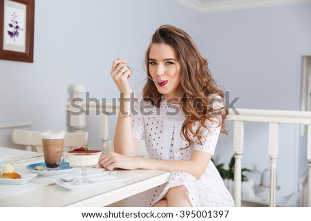 beautiful happy woman sitting at a table with latte macchiato and a ebook reader Stock photo © Rob_Stark