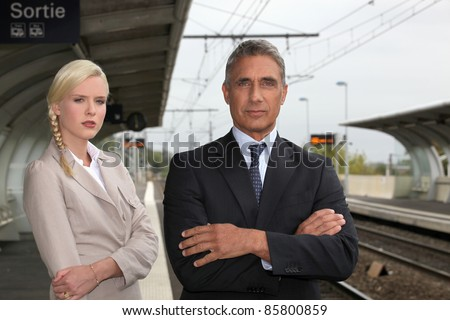 a blonde woman and a mature man well dressed in a train station Stock photo © photography33