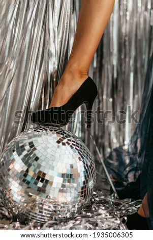 woman in black stockings with disco ball Stock photo © dolgachov