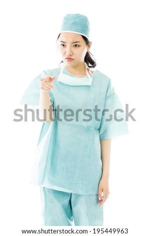 Angry Asian female surgeon scolding someone isolated on white background Stock photo © bmonteny