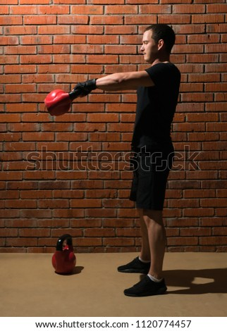 concentrated athletic man holding red kettlebells weights lifted Stock photo © feelphotoart