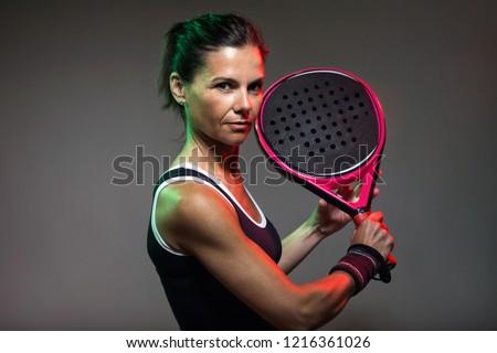 Portrait of beautiful woman playing tennis indoor. Isolated on black.  Stock photo © nenetus