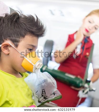 Dziecko samolot potrzeba pierwszy awaryjne Zdjęcia stock © zurijeta
