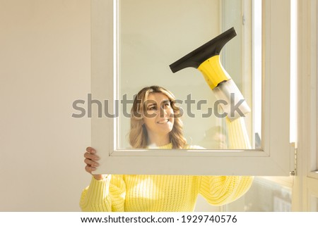 Young pretty woman holding cleaning tools and products in bucket stock photo © Yatsenko