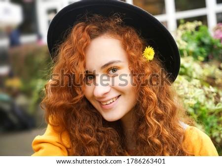 Beautiful young woman in the gardens wearing a long red dress Stock photo © artistrobd