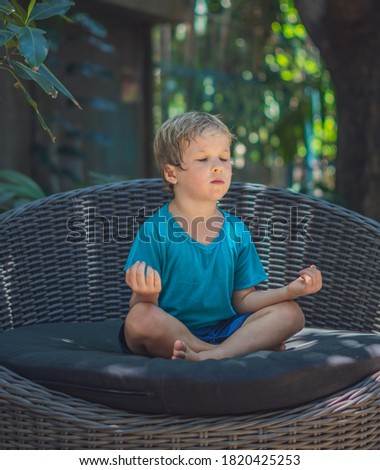 young blond boy meditating with closed eyes in lotus pose yoga stock photo © nadia_snopek