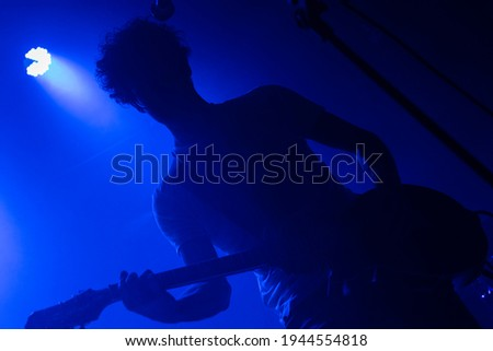 Male guitarist performing with curly hair at nightclub Stock photo © wavebreak_media