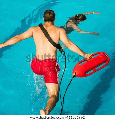 Lifeguard jumping into a swimming pool to rescue drowning senior man Stock photo © wavebreak_media