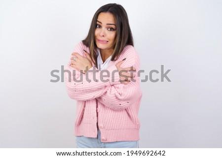 Portrait of beautiful desperate scared frightened young muslim woman wearing black hijab holding kni Stock photo © Traimak