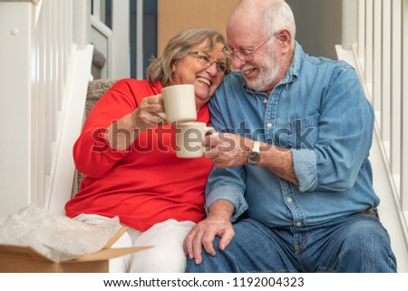 Tired Senior Adult Couple Resting on Stairs with Cups of Coffee  Stock photo © feverpitch