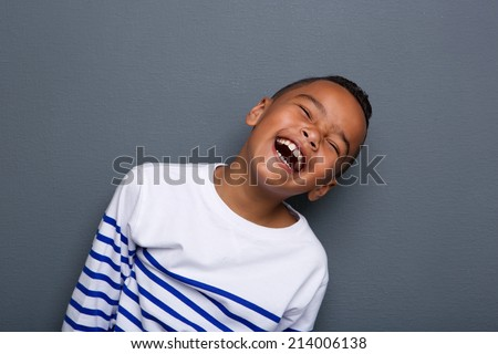 Portrait of excited african american boy laughing and grabbing h Stock photo © deandrobot