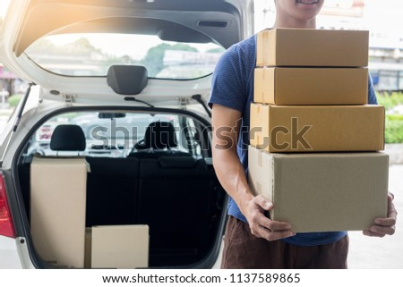 Delivery Loader Postman in blue uniform holding pile of cardboar Stock photo © snowing
