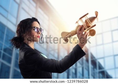 Businesswoman play with a toy aircraft. Concept of company startup and business success Stock photo © alphaspirit