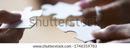 Pessoas de negócios trabalhar juntos construir quebra-cabeça trabalho em equipe Foto stock © alphaspirit