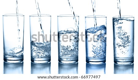 Bottle of sparkling mineral water with glass of ice and green cloth on white Stock photo © DenisMArt