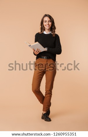 Full length image of young european woman 20s holding takeaway c Stock photo © deandrobot