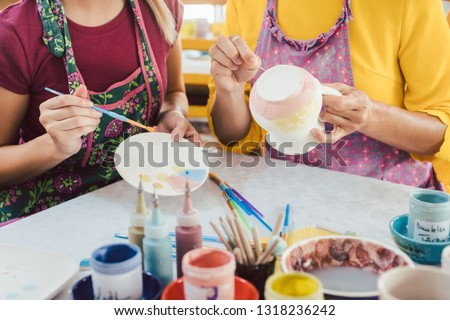 Women in DIY workshop coloring and decorating their own ceramic Stock photo © Kzenon