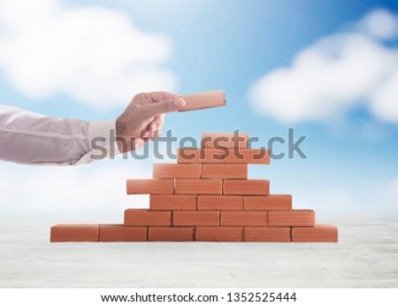Stockfoto: Zakenman · baksteen · bouwen · muur · nieuwe · business