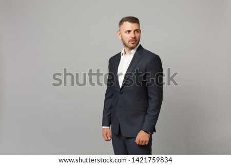 Image of stylish handsome man 30s in businesslike suit sitting o Stock photo © deandrobot