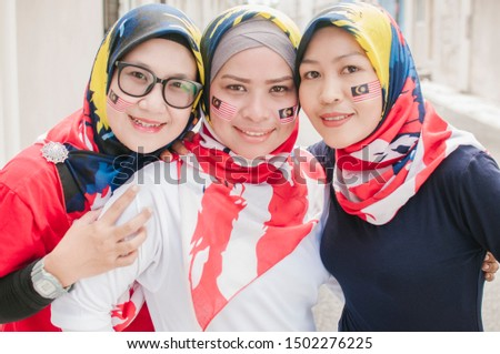 Young woman travels in Malaysia. Holds the Malaysian flag BANNER, LONG FORMAT Stock photo © galitskaya