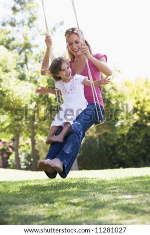 Madre figlia swing parco parco giochi Foto d'archivio © Lopolo