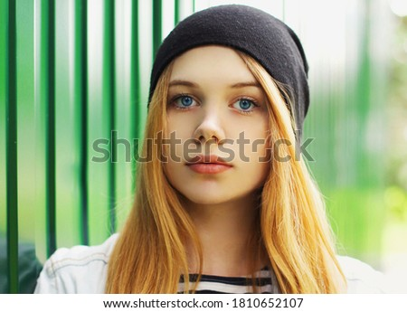 Close up of millennial woman with camera in Summer hat against light grey background Stock photo © wavebreak_media