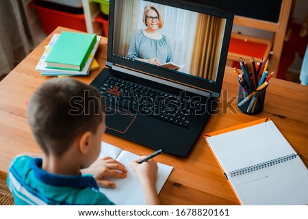 Stock photo: A teacher, a tutor for home schooling and a teacher at the table. Or mom and daughter. Homeschooling