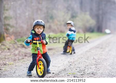 Two little boys children having fun on Balance Bike on the bridge Stock photo © galitskaya