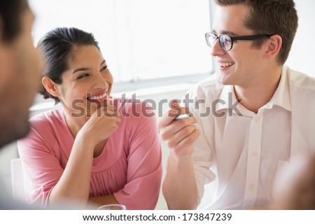 front view of young mixed race business people discussing over laptop standing in modern office stock photo © wavebreak_media