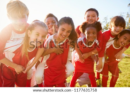 Happy Sports Team. Kids In Elementary School Sports Team Raising Golden Trophy. Children Youth Playe Stock photo © matimix