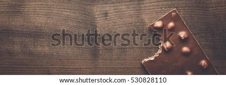Bandeira chocolate peças avelã nozes Foto stock © Illia