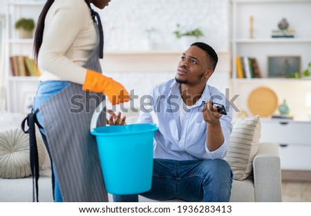 The wife has to do clean the house while her man is watching TV Stock photo © Kzenon