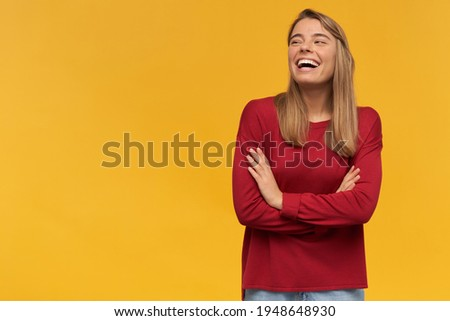 Happy funny young female with pleasant appearance, gestures with both hands, shows okay sign and ton Stock photo © vkstudio