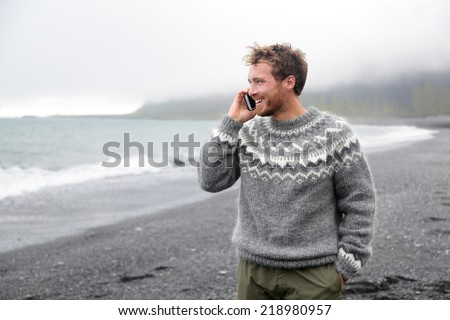 Good looking smiling male wears warm winter clothes holds firewood, stands near tree, spends free ti Stock photo © vkstudio