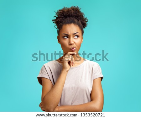 Photo of dark skinned Afro American woman with curly bushy hair, wears protective mask during corona Stock photo © vkstudio