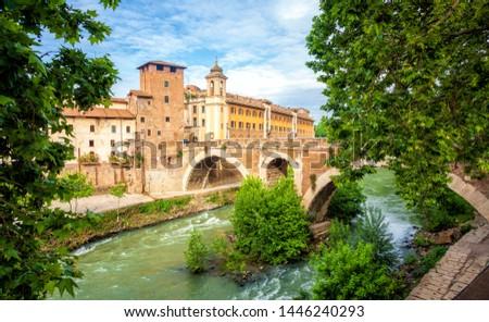 Rome. Tiber Island or Isola Tiberina on river in Rome view, The  Stock photo © xbrchx