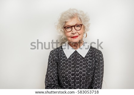 Image of happy caucasian woman in eyeglasses expressing surprise Stock photo © deandrobot